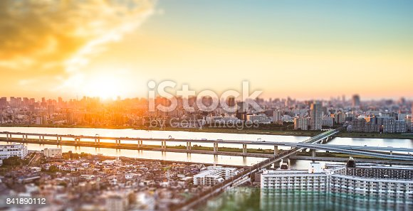 1184122904 istock photo tokyo city skyline under dramatic sunset glow and beautiful cloudy sky in Tokyo, Japan. Miniature Tilt-shift effect 841890112