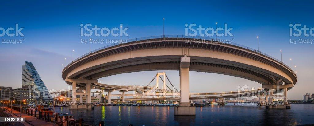Tokyo harbour Rainbow Bridge curving over bay to Odaiba Japan stock photo
