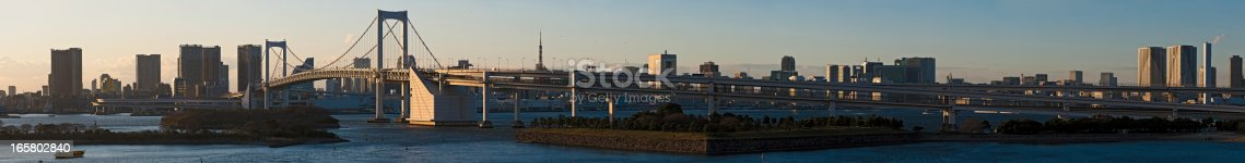 928415496 istock photo Tokyo Harbour Rainbow Bridge super panorama cityscape Japan 165802840