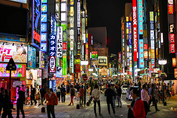 tokyo in the night - shinjuku ward stock photos and pictures