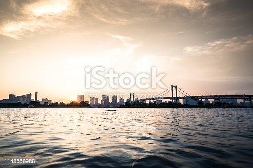 928415496 istock photo Tokyo, Japan at Rainbow Bridge spanning the bay 1148556986