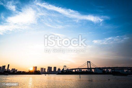 928415496 istock photo Tokyo, Japan at Rainbow Bridge spanning the bay 1148556987