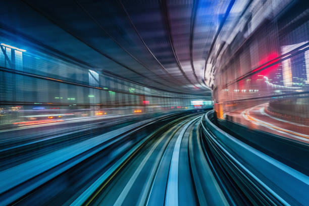 Tokyo Japan High Speed Train Tunnel Motion Blur Abstract High speed train driving along the rails through a train station tunnel at night. Motion Blur. Long Exposure. Edited, Composite Night Skyline. Odaiba, Tokyo, Japan, Asia the way forward stock pictures, royalty-free photos & images