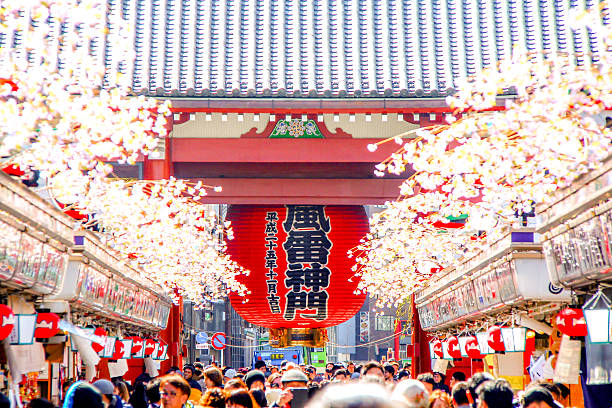 Tokyo, Japan - March 02, 2015 - Sensoji Temple Tokyo, Japan - March 02, 2015 - Big red Japanese lantern around with Cherry Blossom in Sensoji Temple. bodhisattva stock pictures, royalty-free photos & images