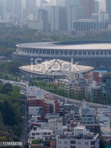 1188904934 istock photo Tokyo Metropolitan Gymnasium and the new Olympic National Stadium 1173133725