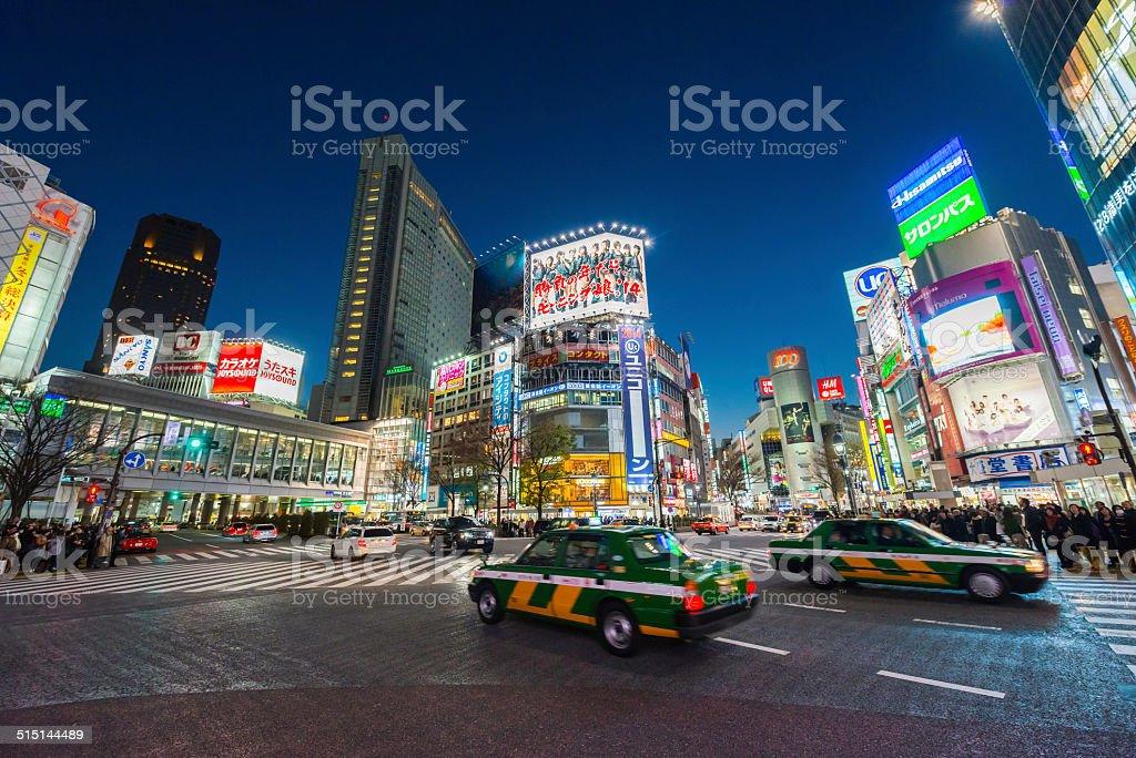 Tokyo neon night illuminated crowds traffic in futuristic cityscape Japan stock photo