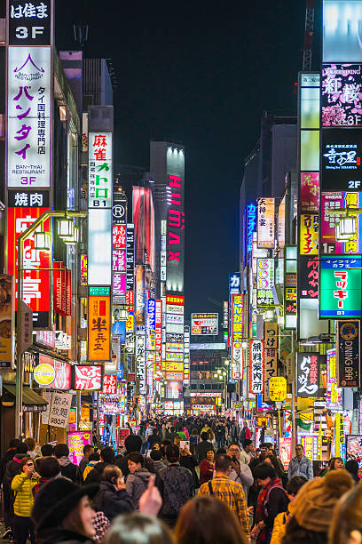 tokyo nightlife crowded streets and colourful neon shopping signs japan - shinjuku ward stock photos and pictures