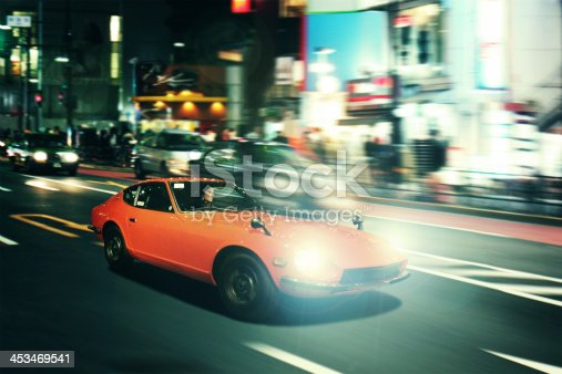 Night pursuit in an oldtimer sportscar on the streets of Shinjuku, Tokyo.