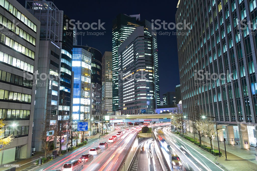 Tokyo Office Buildings and Traffic at Night stock photo