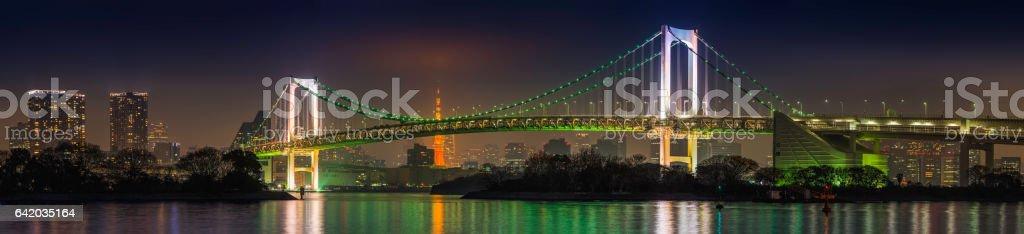 Tokyo Rainbow Bridge from Odaiba Tokyo Harbour night panorama Japan stock photo