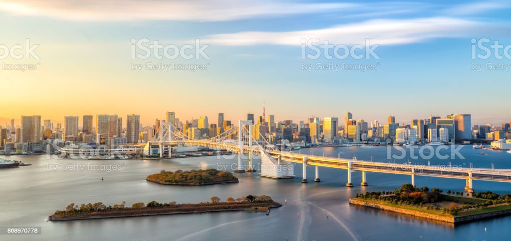 Tokyo skyline with Tokyo tower and rainbow bridge stock photo