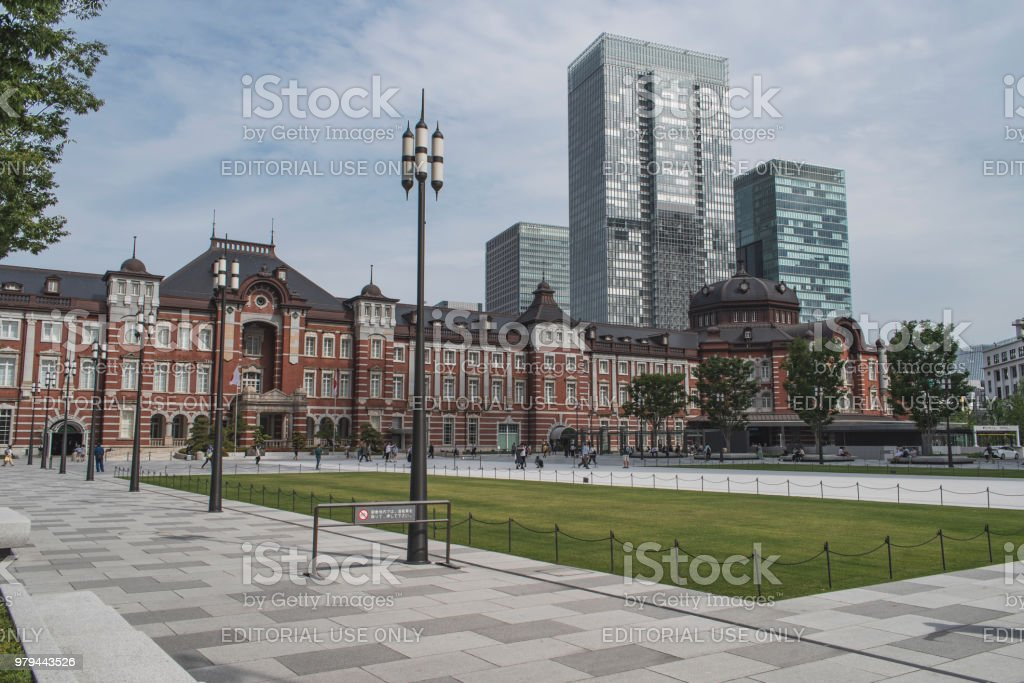 Tokyo Station at daytime. Tokyo Station is a broad, imposing brick building in the Marunouchi business district just east of the Imperial Palace. stock photo
