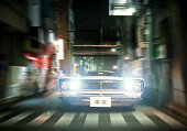 Speeding oldtimer car on the streets of Tokyo.Plates are custom made by me. Image composite.