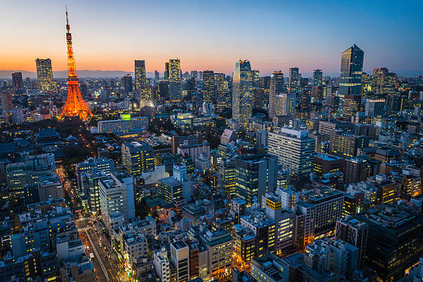 Tokyo Tower crowded aerial cityscape skyscrapers neon lights sunset Japan stock photo