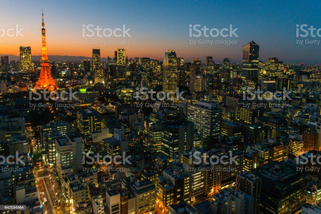 Tokyo Tower futuristic skyscraper cityscape illuminated at dusk Japan stock photo