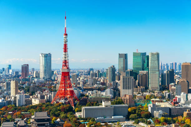 tokyo tower, japan -  tokyo city skyline and cityscape - tokyo japan stock photos and pictures