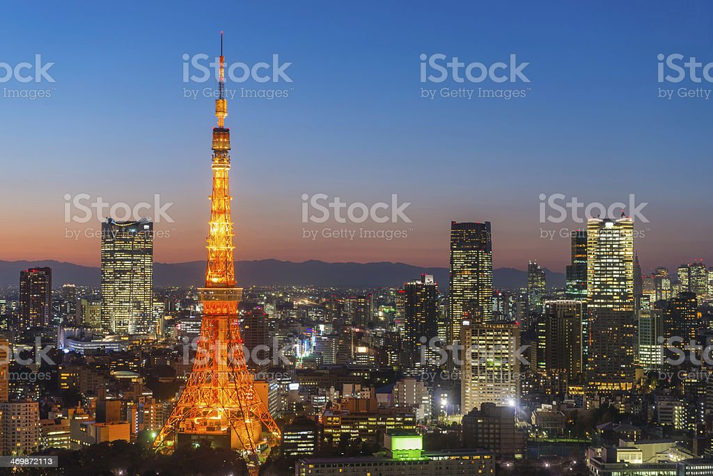 Tokyo Tower neon night skyscrapers crowded cityscape illuminated Japan stock photo
