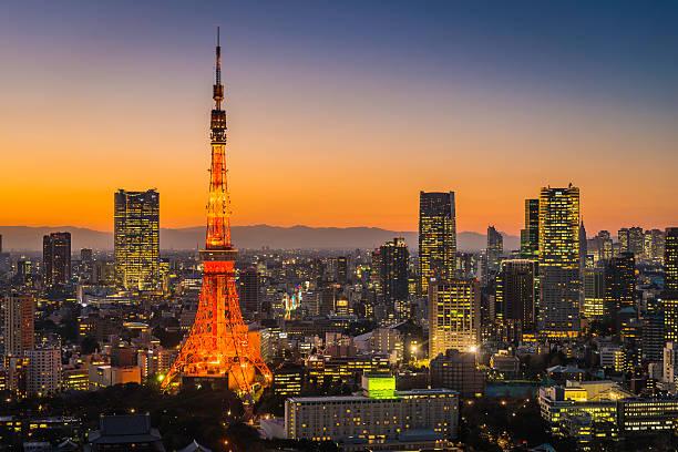 Tokyo Tower skyscrapers neon futuristic cityscape illuminated sunset Japan stock photo