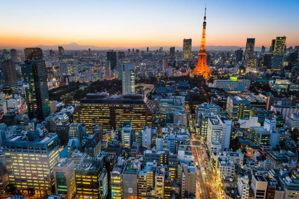 Tokyo Tower sunset aerial view over crowded cityscape lights Japan stock photo