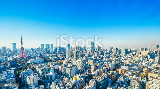 931105838 istock photo tokyo tower under blue sky and sunny day in hamamatsucho, Japan 946516772