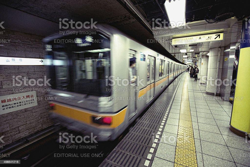 Tokyo underground Train leaving station stock photo