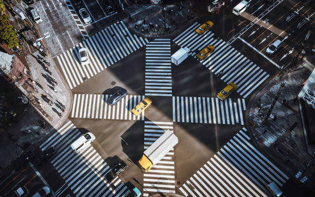 Tokyo urban traffic Aerial View of a Crossing in Ginza road intersection stock pictures, royalty-free photos & images