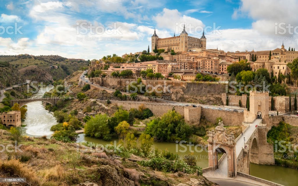 Toledo view from alcantara bridge, Spain Toledo cityscape with Alcantara bridge (Puente de Alcantara) over Targus river. Spain 2019 Stock Photo