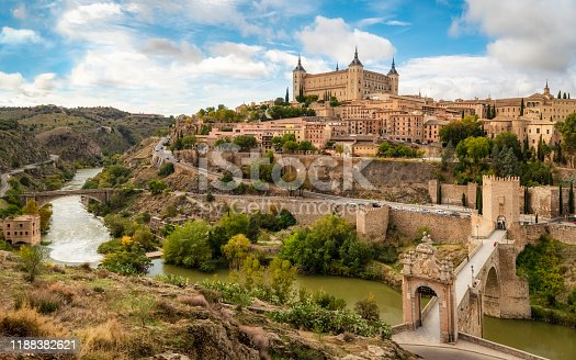 Toledo cityscape with Alcantara bridge (Puente de Alcantara) over Targus river. Spain