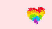 istock Tolerance, kindness, cooperative, friendship, charity humanitarian aid day concept. Many rainbow color palm hands on pink background with copy space 1285822272