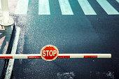 toll bar, stop sign, road, zebra crossing