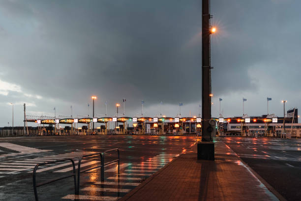 toll booth in calais on rainy evening - doncaster foto e immagini stock