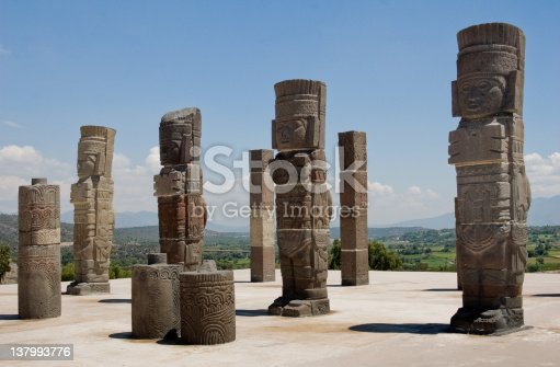 The ruins of an ancient Mesoamerican city from the Toltec empire in Tula, Mexico. The remaining columns of the temple are sculptures of warriors sometimes referred to as the Atlantians.