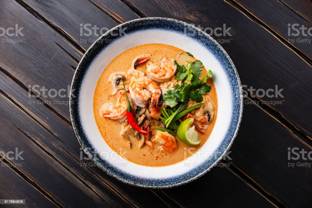 Tom Yam kung Spicy Thai soup in bowl stock photo