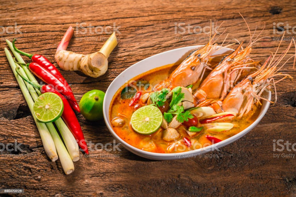Tom Yum Goong Thai hot spicy soup shrimp  with lemon grass,lemon,galangal on wooden background Thailand Food stock photo