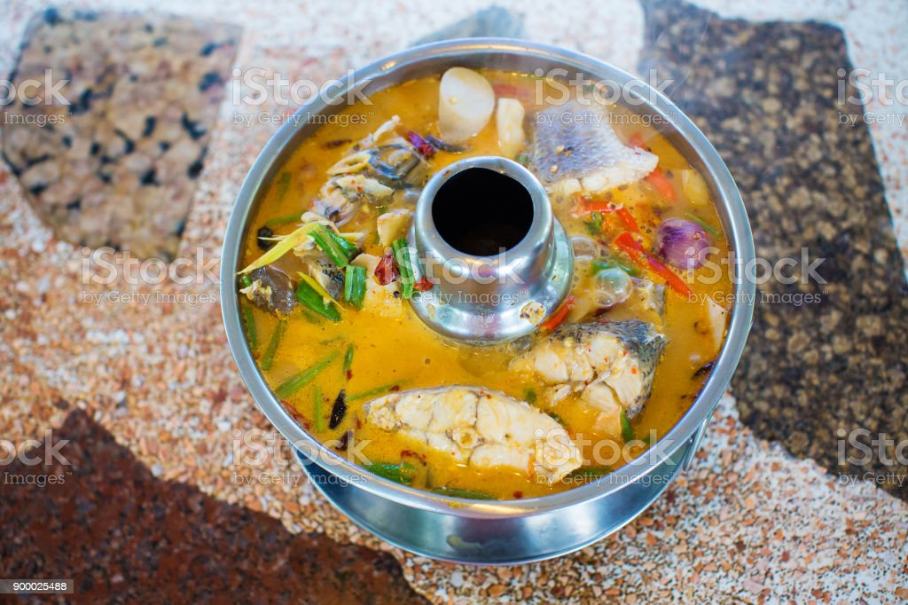 Tom Yum Seafood, shrimp, shell, fish and crab recommend Thai local food for traveler and tourist. stock photo