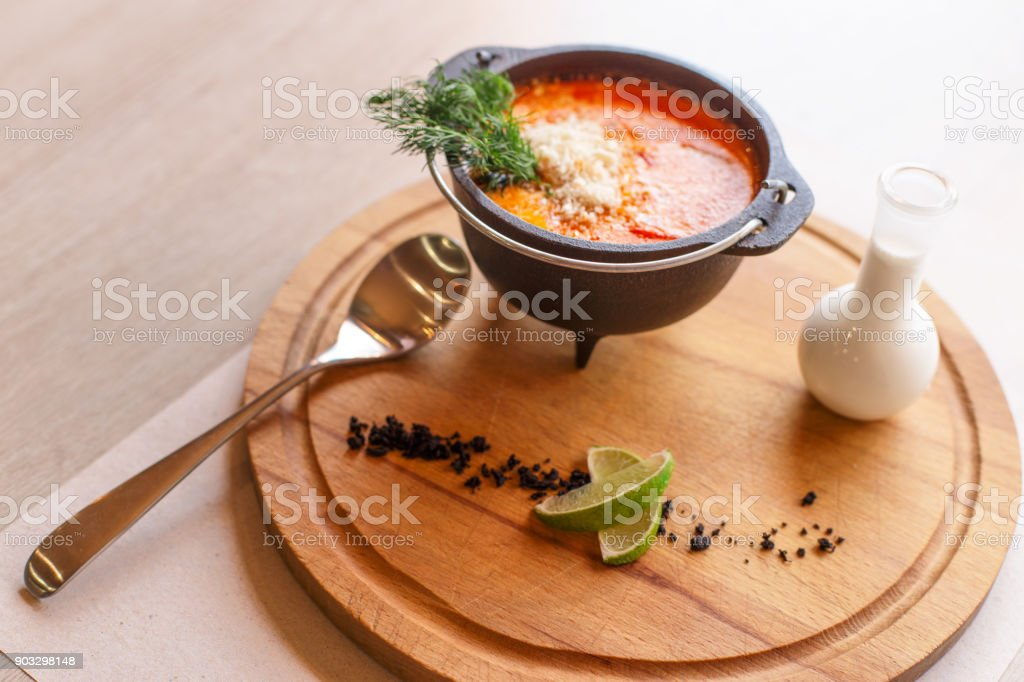 Tom yum soup serving stock photo