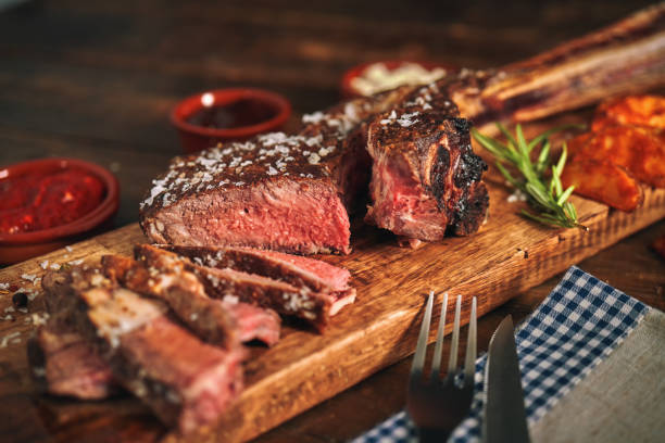 Tomahawk Steak with Country Potatoes stock photo