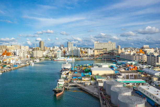 Tomari Port with Okinawa city skyline in Naha, Okinawa, Japan Tomari Port with Okinawa city skyline in Naha, Okinawa, Japan. naha stock pictures, royalty-free photos & images