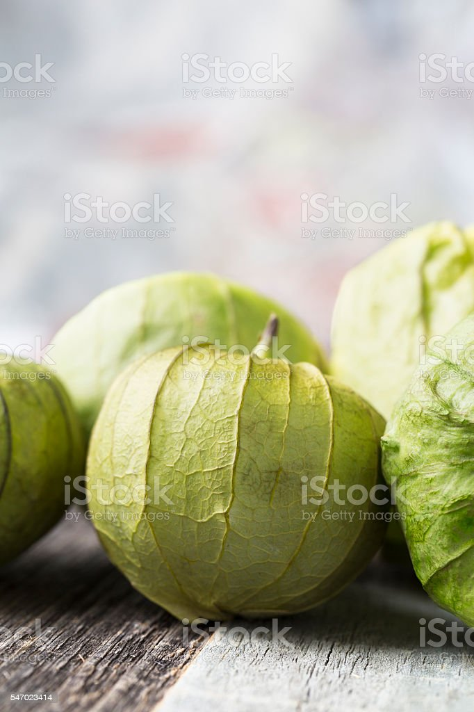 Tomatillos on Table Vertical stock photo
