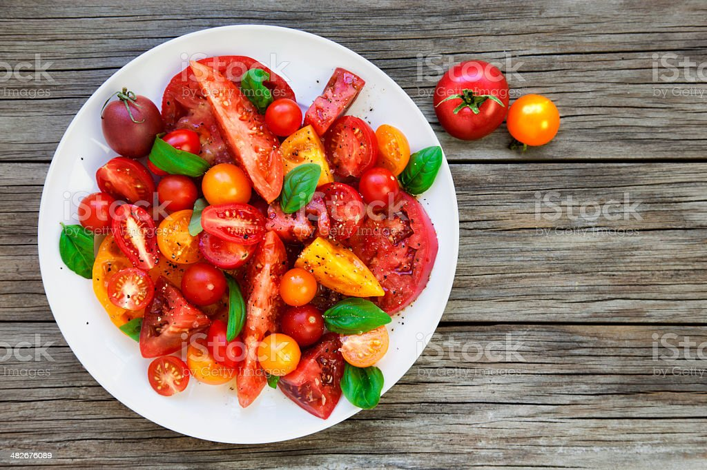 Tomato and basil salad stock photo