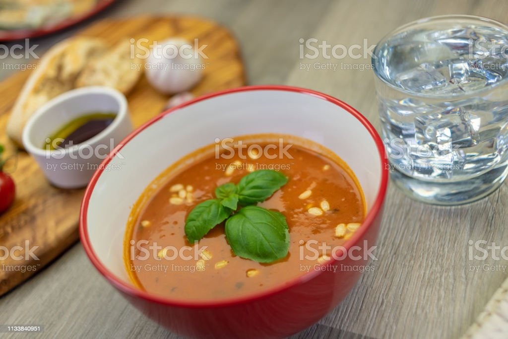 Tomato and basil soup with bread stock photo