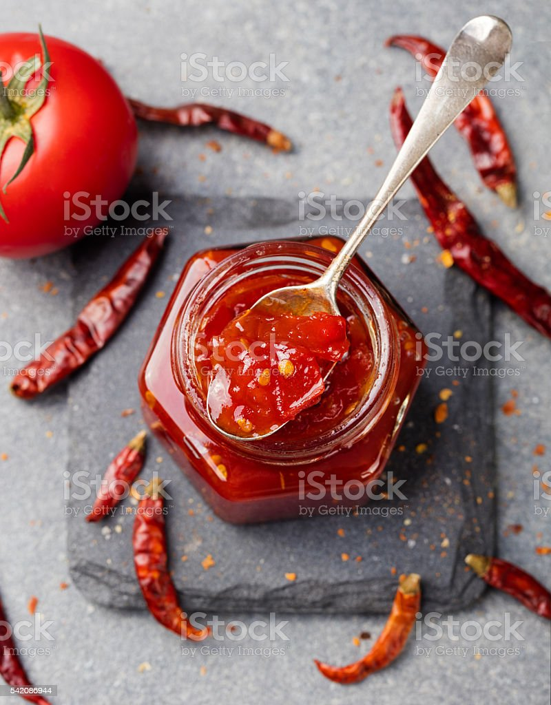 Tomato and chili sauce, jam, confiture in a glass jar stock photo