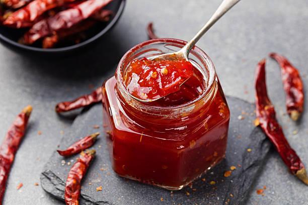 tomato and chili sauce, jam, confiture in a glass jar - confiture tomatoes imagens e fotografias de stock