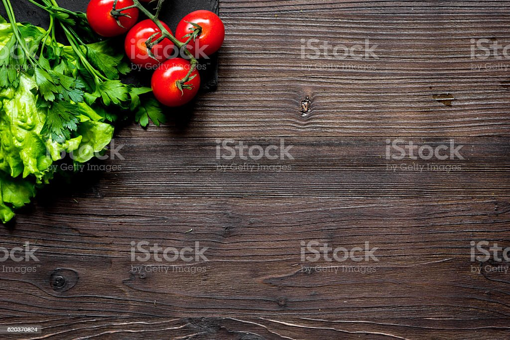 tomato and fresh salad on dark wooden background top view foto de stock royalty-free