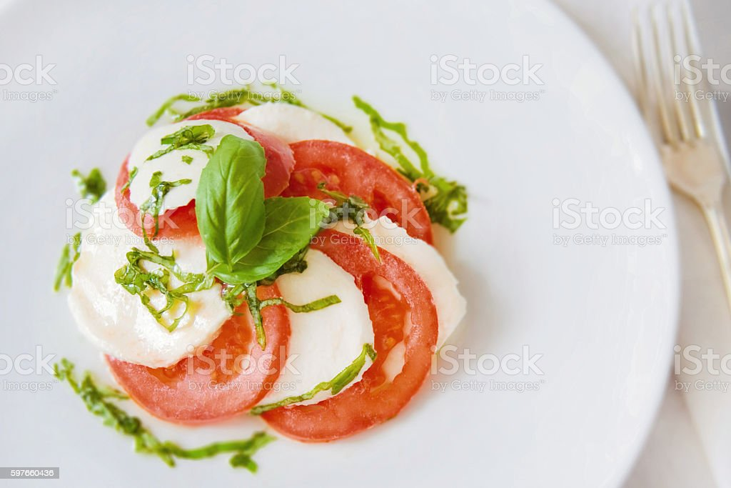 Tomato and Mozzarella Salad with Basil and Olive Oil stock photo