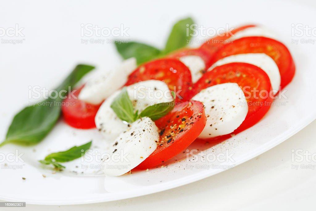 Tomato and mozzarella slices on a plate royalty-free stock photo