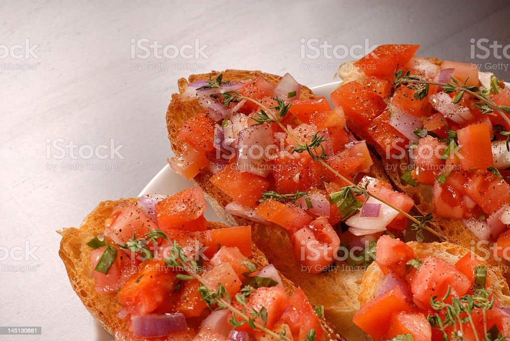 Tomato and onion bruschetta with thyme royalty-free stock photo