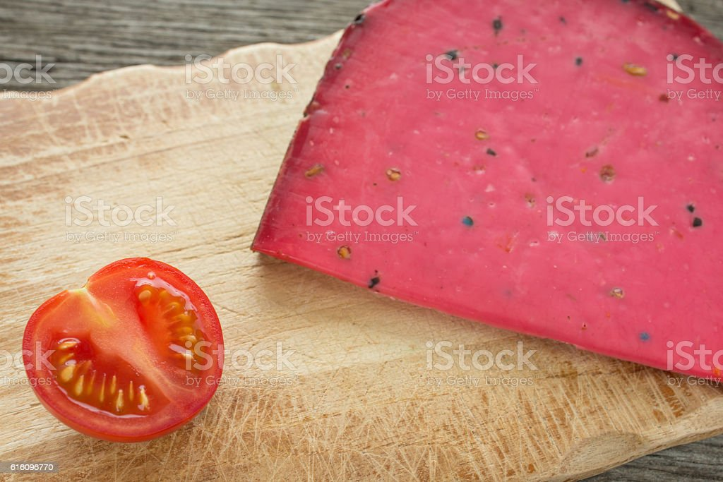Tomato and red cheese Tomme du Berry from France stock photo
