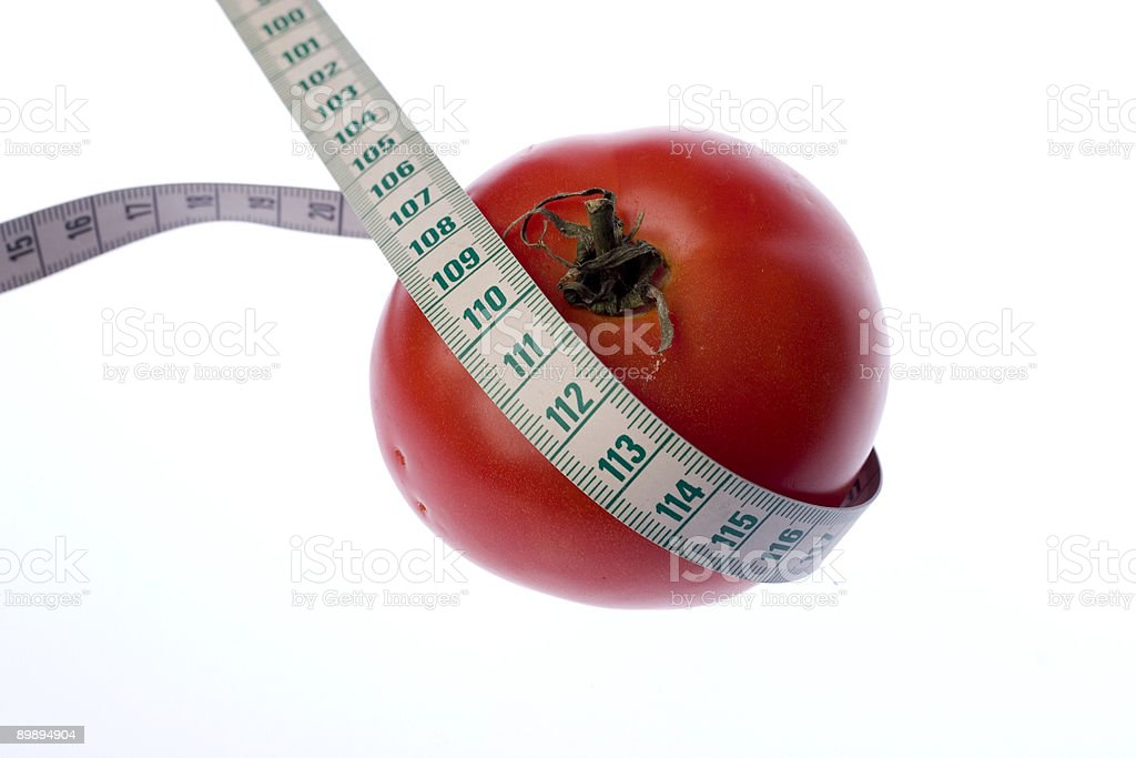 tomato and tape measure royalty-free stock photo