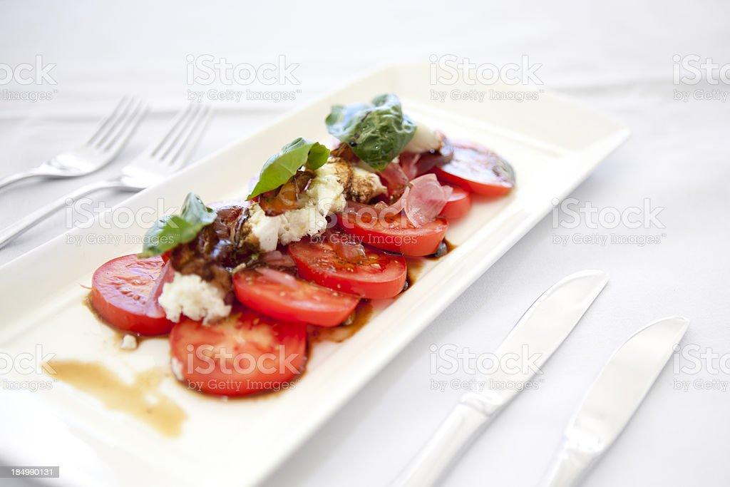 Tomato, basil & mozzarella salad entree royalty-free stock photo